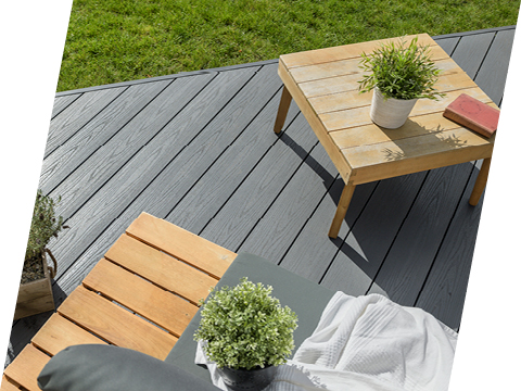 Wooden table on decking