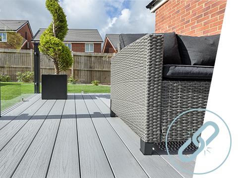 A grey UPVC deck with a sofa area