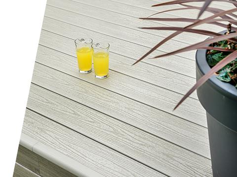 Two glasses of orange juice on a UPVC deck